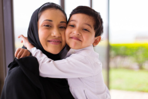 muslim boy hugging his mother
